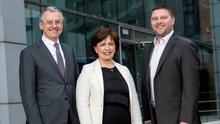 From left: Kevin Holland, CEO of Invest NI, Economy Minister Diane Dodds, and Darren Dillon of Microsoft