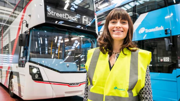 Minister for Infrastructure Nichola Mallon stands beside the Wrightbus prototype hydrogen bus