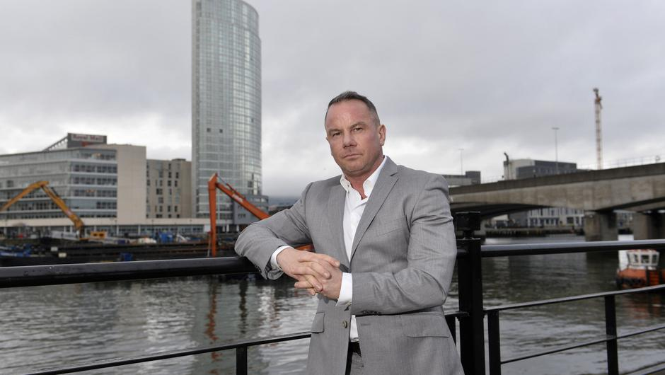 Tom Smyth near the Obel building in Belfast, where Dream Apartments began
