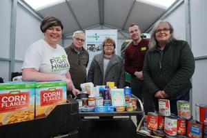 Asda Larne community champion Catherine McCallion (left), with representatives from Larne Food Bank and Stuart Legge, Asda Larne general store manager (second from right)