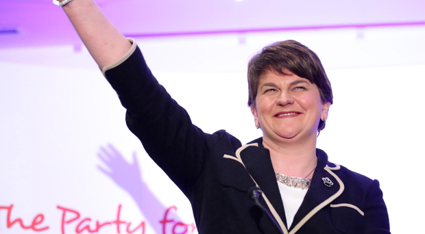 DUP leader Arlene Foster waves to her party members