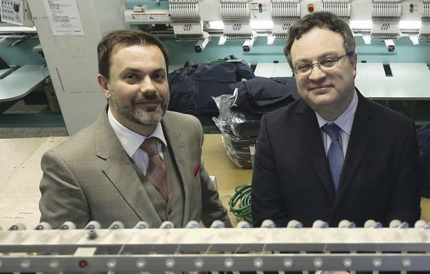 Stephen Farry with Simon Hunter, MD of Hunter Apparel
