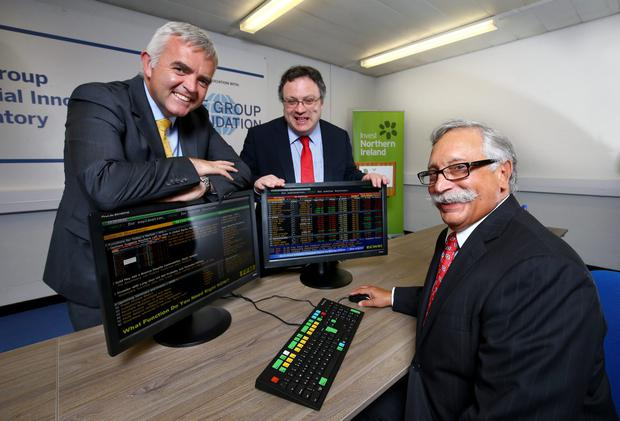 Enterprise Trade and Investment Minister Jonathan Bell and Employment and Learning Minister Dr Stephen Farry with Jim Oliff, CME Group Foundation chairman after officially opening the new CME Group Financial Innovation Laboratory at the Ulster University