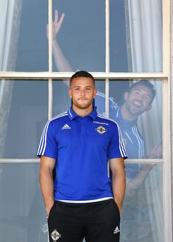 Northern Ireland's Gareth McAuley acts up as Conor Washington has his photograph taken during a media day at Carton House Hotel in Co Kildare ahead of the Euro 2016 Championships in France