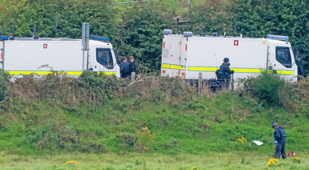 Army ATOs search fields at the scene of the security alert in Lettershandoney outside Londonderry