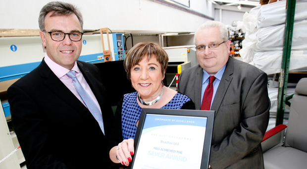 From left, chief executive of Invest NI, Alastair Hamilton, with Patricia Clements, managing director of Bradfor Ltd and David Quin, supply chain director of customer Rockwell Collins