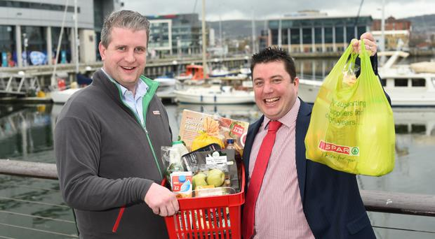 James Eyre, commercial director, Titanic Quarter, and Andy Davis, co-owner of Spar Titanic Quarter, celebrate the opening of the new store