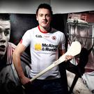 Tyrone hurler Damien Casey models the county's O'Neills shirt in 2015