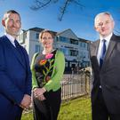 Marine Hotel owners Colum McLornan and Claire Hunter with Stephen Comer from First Trust Bank outside the newly refurbished premises