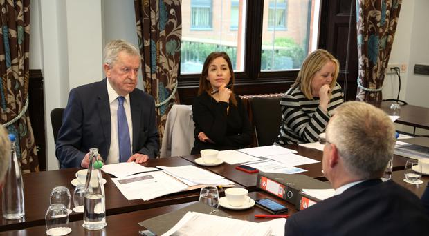 The judges' deliberations: Richard Donnan, head of Ulster Bank (back to camera) and (l to r) John Simpson, Tanya Anderson and Kirsty McManus of the panel