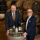 Colin Neill, chief executive of Hospitality Ulster, with Jarlath Watson, finance director at Echlinville Distillery, at their site in Newtownards
