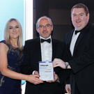 Catherine McAlynn and James Maguire from SPAR NI being presented with the Best Use of Digital and/or Social Media by Mark Hanna of category sponsor Mascott Construction at the event in 2017