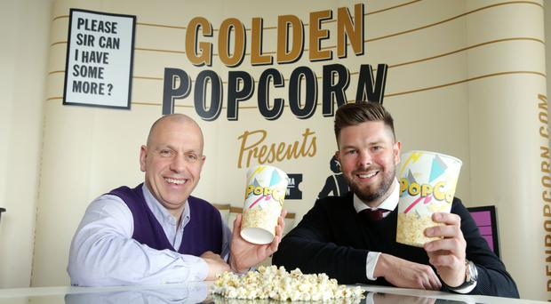 John Hood of Invest NI and Sean McClinton, managing director of Golden Popcorn