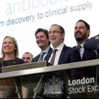 Fusion Antibodies CEO Paul Kerr (centre) and its advisers and representatives at the London Stock Exchange