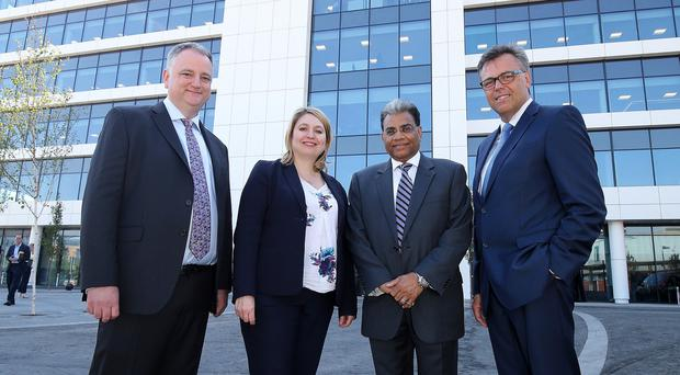 Allstate's John Healy (left) and Suren Gupta (second right) with Secretary of State Karen Bradley and Alastair Hamilton of Invest NI