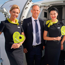 Staff from Air Baltic show off their newly rebranded A220 at the Farnborough Airshow yesterday