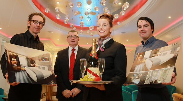 From left, Paul Jackson, Consarc Design, with George Graham, general manager at Crowne Plaza, Stacey Feeney, conference and banqueting manager, and Ronan Donaghy, Philip Rodgers Design