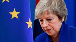 Theresa May speaks after a special session of the European Council over Brexit