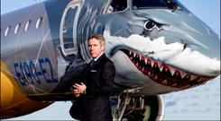 John Slattery, CEO of Embraer Commercial Aviation, with the new Embraer E190-E2 passenger jet