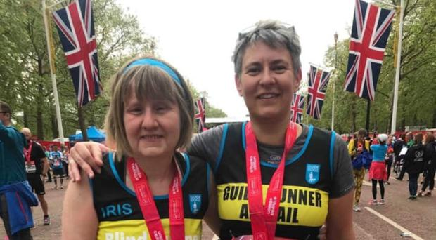 Iris Peel (left) with her guide Abigail Cast after competing in the London Marathon