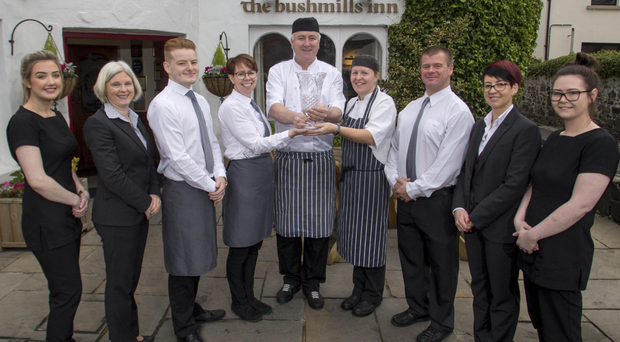 Nikki Picken, sales and marketing manager, and Kerry McIntyre, duty manager, with staff after The Bushmills Inn won the IAGTO award