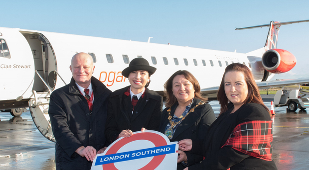 Loganair crew with Mayor Michaela Boyle and airport manager Charlene Shongo