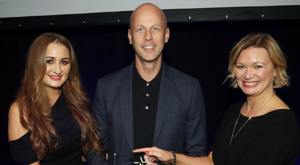 John Lennon (centre), managing director of Novosco, presents Angela Bell (right) and Victoria Logan from Allstate as winners in the Cyber Security Project of the Year category at the Belfast Telegraph IT Awards