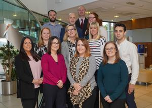 Front row: Square Box training consultant Lorraine Campbell, Jenna Devine, Caroline Lavery and Hayley Beattie. Second row: Lisa Bower, SHS CEO Elaine Birchall, Kerry Henry and Adam Megahey. Third row: Peter Grimley, David Gavin, Aaron Campbell and Torr Coggan