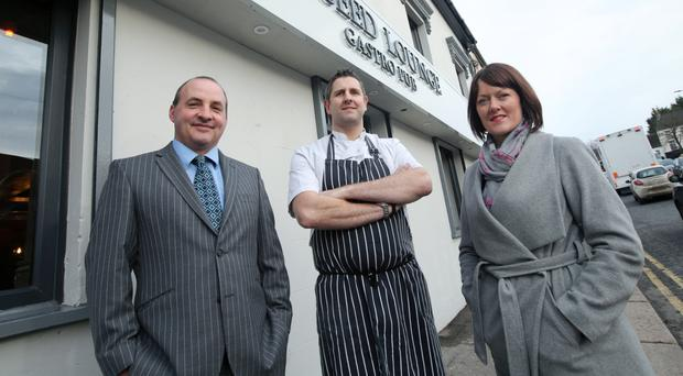 Derick Wilson (left), business development manager at Ulster Bank, and Nick and Joanne Clough, owners of the Aniseed Lounge