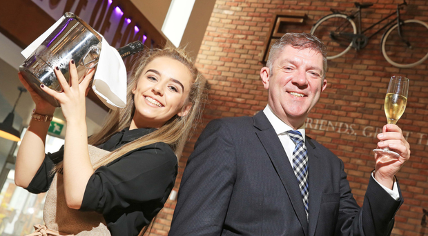 Belfast Met events management student Rebecca McNicholas (20) with Adrian McNally, general manager of Titanic Hotel Belfast. Ms McNicholas took part in a week-long hospitality training course at the Met in preparation for her employment at the highly anticipated hotel, which opens to guests next weekend