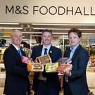 Genesis Crafty managing director Brian McErlain (left) and JP Lyttle, commercial director (right), launch the new small cake lines at M&S Sprucefield with Ryan Lemon, M&S head of region Northern Ireland