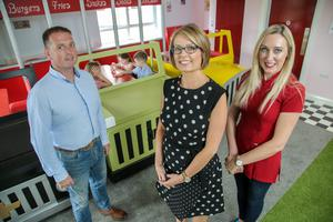 Danske Bank business acquisition manager Bernie Kerr (centre) with Sean and Martina O'Hanlon, who own Busy Kids Daycare