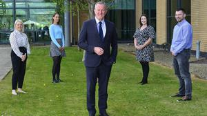 Finance Minister Conor Murphy with some current EO1s and EO2s: Jill McKendry, Louise Boyd, Debra Rice and Shaun Buchanan. Pic Department of Finance