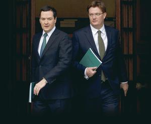 Chancellor George Osborne (left) and his deputy Danny Alexander leave the Treasury for the House of Commons yesterday to deliver his annual Autumn Statement