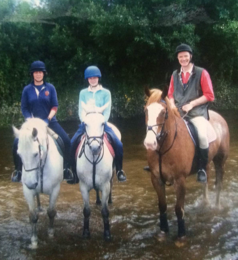 Owen Brennan (right) horse riding with his family