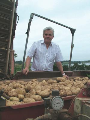 Mash Direct founder Martin Hamilton with a crop of potatoes