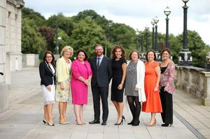 Economy Minister Simon Hamilton at the Stormont event with, from left to right, Jackie Henry, Tracey Hamilton, Tina McKenzie, Professor Deirdre Heenan, Roseann Kelly, Ann McGregor and Eleanor McEvoy