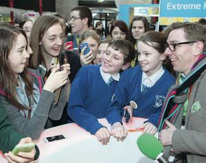The Late Late Show host Ryan Tubridy with pupils at the BT Young Scientist and Technology Exhibition in the RDS last year