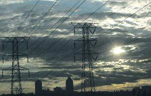 File photo of electricity pylons in Johannesburg's Alexandra township...Electricity pylons in Johannesburg's Alexandra township stand against the skyline of the city's Sandton business district in this May 25, 2008 file photo. South Africa's electricity crisis will remain for years and power cuts will continue well into the future, state-owned utility Eskom said on Thursday. Picture taken May 25, 2008.     REUTERS/Mike Hutchings/Files  (SOUTH AFRICA)...I