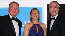 Richard McClean, Managing Director of the Belfast Telegraph, and Ulster Bank's Richard Donnan present Janet McCollum of Moy Park with her award last night