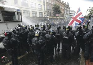 Police face down loyalists protesting about a republican internment anniversary parade in August – during the Police and Fire Games in Belfast