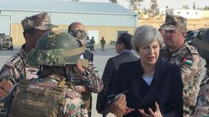 Prime Minister Theresa May speaks to troops as she arrives in Amman, Jordan