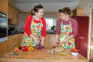 Erin Bunting (left) and Jo Facer prepare their ingredients for another supper club