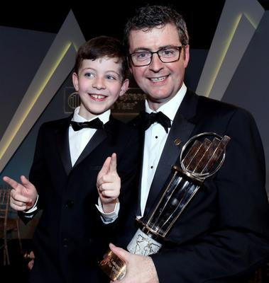 Brendan Mooney with son Odhran after picking up his accolade