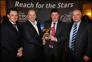Former RTE Dragons' den personality Sean Gallagher (second left) presented the award to Philip Hanlon, Rory Byrne and Charlie Corscadden from the company