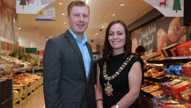 Lidl operations executive Paul Gibson joins Lord Mayor Nichola Mallon at the chain's new Belfast city centre store on High Street