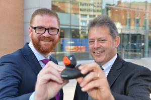Economy Minister Simon Hamilton with Lou Shipley, president and CEO of Black Duck Software, which has announced it is moving to Belfast