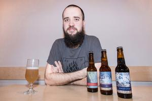 Matthew Dick, co-founder of the Boundary Brewing firm, with his products