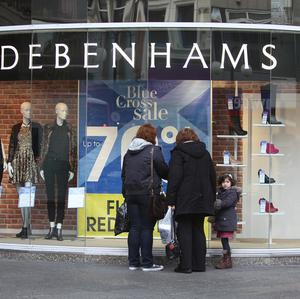 Better weather has driven a turnaround in sales at department store Debenhams.