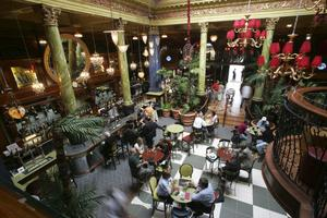 The ornate listed Cafe Vaudeville in Arthur Street, Belfast, boasts lavish 'art nouveau' decor and features a central atrium and sweeping staircase